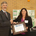 Michael Ellenbecker of TURI presenting the award to Sigalle Reiss of the Norfolk 7