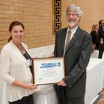 Alexandra Depalo from the Town of Hudson accepts award from Michael Ellenbecker of TURI