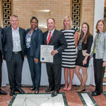 Rep. John Rogers presents citation to Seimens Healthcare Diagnostics