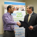 Anuj Mohan of Chemgenes accepting citation from Senator Bruce Tarr
