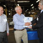 Michael Nahorniak & Charlie Flanagan from Independent Plating accepting recognition from Michael Ellenbecker of TURI