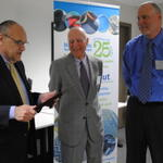 Scott Fortier, (OTA) presents certificate to Shawmut Corporation