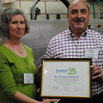 Joy Onasch presenting award to Ernie Barbato of Mr. Johns Cleaners
