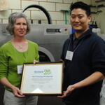 Joy Onasch presenting award to Joon Han of AB Cleaners