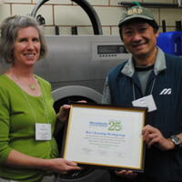 Joy Onasch presenting award to Tam Le of T&P Cleaners