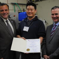 Representative Paul McMurtry, Joon Han (AB Cleaners), Representative Brian Ashe (from left to right)