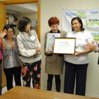 Liz Harriman, TURI (right) presenting the Champions of Toxics Use Reduction Award