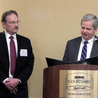 William Judd (Left) receiving the TURP proclamation from Martin Suuberg (Right)